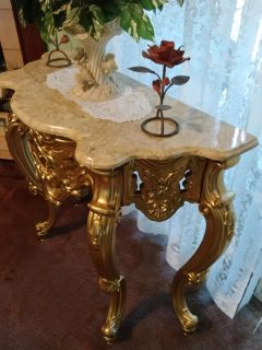 Vintage, beautifully detailed, golden, marbletop accent table.