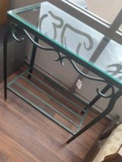 wrought iron and glass stand