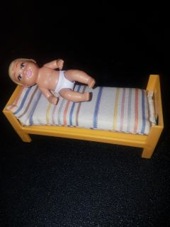 Cute vintage baby doll and bed for dollhouse