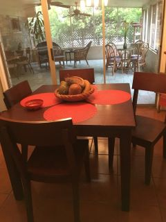 Solid wood table and 5 chairs with self storing leaf