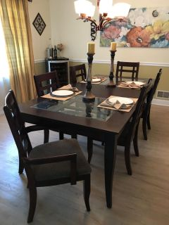 Wood and glass dining room table with 6 chairs