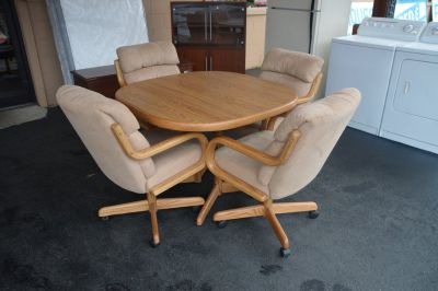 Oak Dinette with 4 Chairs on rollers