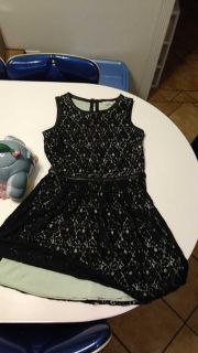 Free. Beautiful two-layered mint green and black dress with leather trim. Size 5. I'm paying it forward. Can not sell.