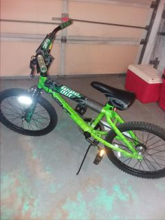 """Boys 20"""" bike wipe out green hardly used"""