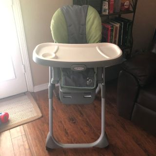 Graco high chair. Back reclines to different positions. White tray comes off to wash. Machine washable cover. chair removes from base.