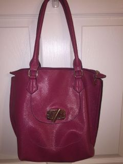 Raspberry colored medium sized tote bag with front pocket brass and top zipper closure. Pocket on inside. Non smoking