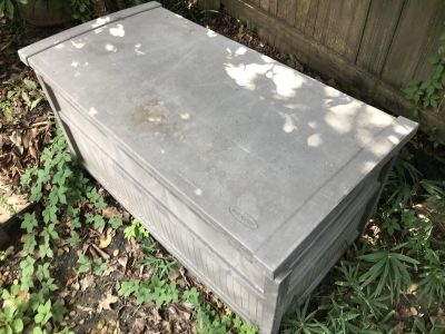 Gray plastic outside storage container.