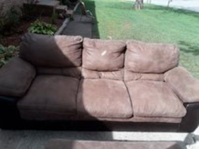 Chair and ottoman set slightly and user