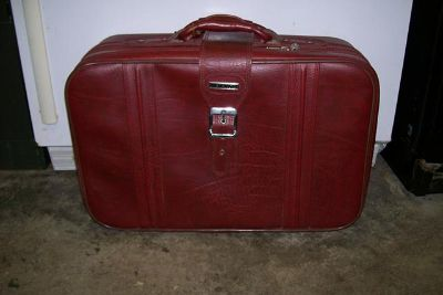 $19, New Vista Faux Red Leather Overnighter Suitcase fits in overhead bin