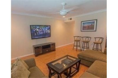 Adorable 2 bedroom townhome just blocks to the beach. Carport parking!