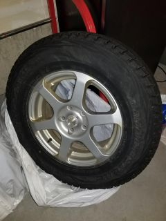 Snow tires, rims and tire rack