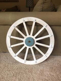Pier 1 wall art! Wood wheel with chips for pictures or memos