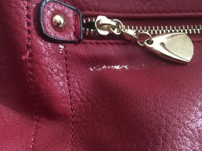 Red me has small white mark by zipper