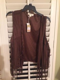 New vest with fringe size large but looks snall