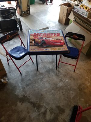 Cars folding table and folding chairs $20 located in Angleton