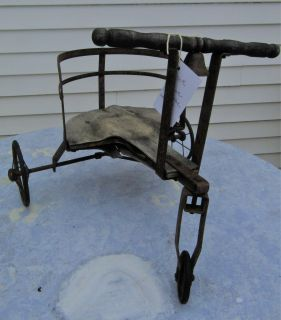 Antique metal trike with bell and wooden seat