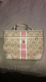 Pink and white coach bag