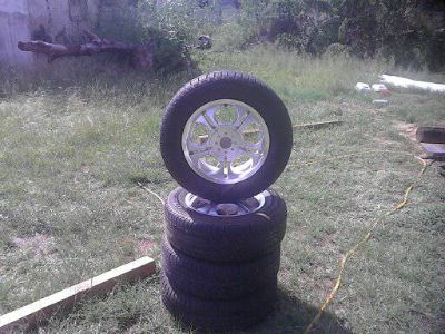 4 good year tire and chrome rims