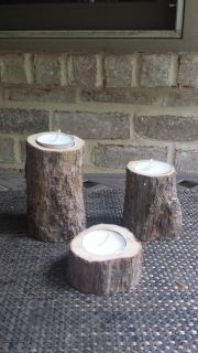 Set of three wood candle holders with candles