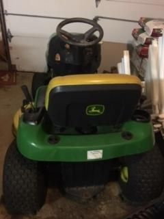 $800, tractor john deere L105   $800 and tiller for sale