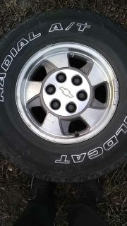 2 stock rim and 2 tires