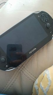 PS VITA NO CHARGER JUST CONSOLE WITH ONE GAME