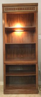 Wood bookcase with display lighting