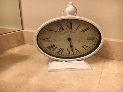 Clock. Antique/ Vintage looking. Great for bathroom , kitchen or office. Sit on shelf or counter