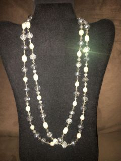Long pearl and shimmery beaded necklace. Can be worn double stranded like shown