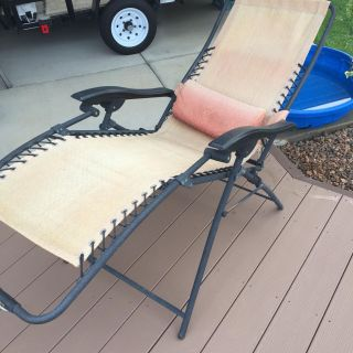 Free zero gravity lounge chair. Canvas faded but is still in good condition. Rust to some of the areas where screws are located. See below