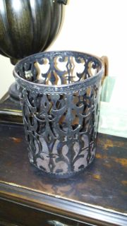 Pierced metal containet