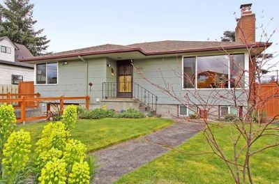Enjoy this spacious 3-bedroom home in the heart of Ballard with attached garage and fenced yard.
