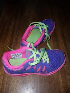Nearly new girls Nike shoes