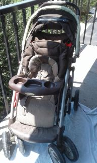 Graco Comfort Tracker easy turn stroller and free Graco pack and play in bag.