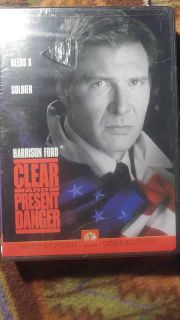 NEW DVD - CLEAR AND PRESENT DANGER - SEALED BUT PLASTIC HAS A TEAR