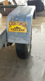 1989 Dolphin Boat and Sportsman Trailer