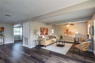 You will love the fresh and bright, open floor plan with custom kitchen cabinets w/ soft close doors