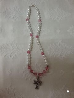 Glass white beads with floating cross