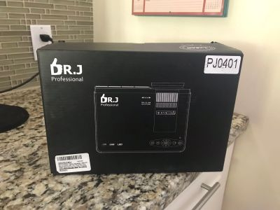 Dr J projector, like new 1080p 2400 lux 176 projector size