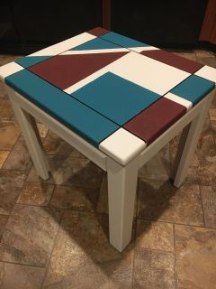 Gorgeous maroon teal and white coffee/end table