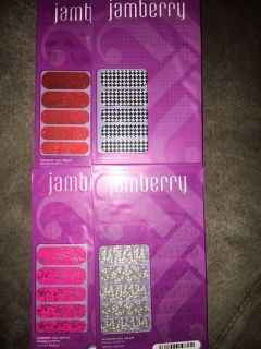4 Unopened Packs of Jamberry Nail Wraps