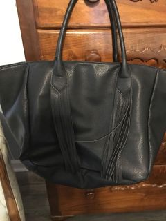 Beautiful and huge fringed leather purse