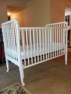 White crib with new mattress