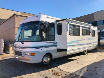 1999 National RV Tropical 6330 With Slide