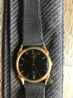 Men s black and gold citizen watch