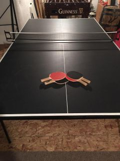 Ping Pong Table w/4 paddles and lots of balls.