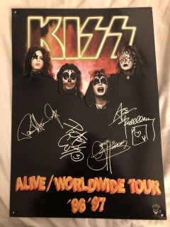 Set of 4 Kiss collectible metal signs