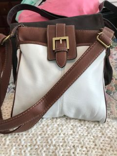 Really nice crossbody purse. Bought at Belk s. In great condition.