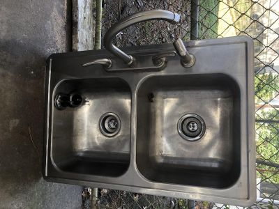 Kitchen sink with fairly new faucet.