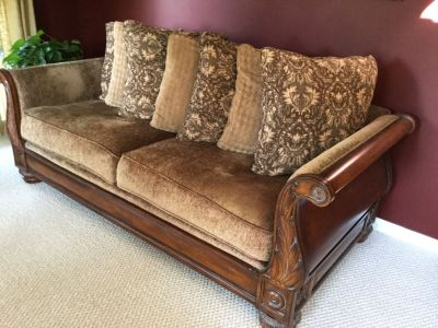 Tan and brown loveseat